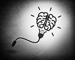 Creative brain idea concept with lightbulb and usb cable - background design